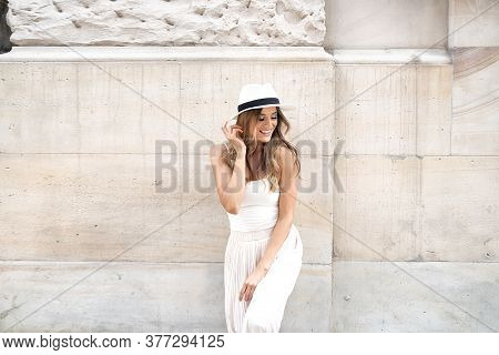 Portrait Of Smiling Woman In Fashionable Hat.