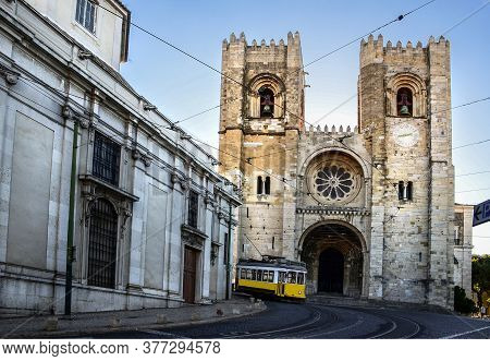 Vintage Yellow Tram In Front Of Se Cathedral, Situated On The Main Road From Baixa To Alfama Charmin