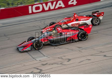 July 18, 2020 - Newton, Iowa, USA: ALEX PALOU (R) (55) of Barcelona, Spain   races through the turns during the  race for the Iowa INDYCAR 250s at Iowa Speedway in Newton, Iowa.
