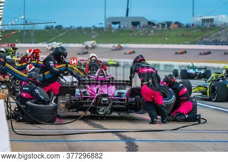 July 18, 2020 - Newton, Iowa, USA: JACK HARVEY (60) of Lincoln, England  brings his car in for service during the Iowa INDYCAR 250s at Iowa Speedway in Newton Iowa.
