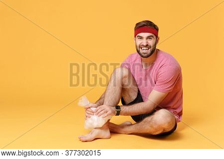 Displeased Bearded Fitness Sporty Guy Sportsman In Headband T-shirt In Home Gym Isolated On Yellow B