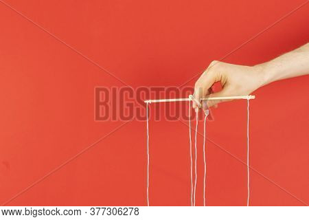 The Controling Your Mind, Twisted Sticks With Ropes In The Hand, Puppet Concept, Isolated