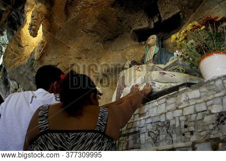 Bom Jesus Da Lapa, Bahia / Brazil - August 4, 2014: Pilgrims Are Seen In A Cave With Miraculous Deed