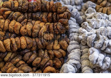 Strings Of Sugar Coated Dried Figs In A Basket For Sale In At An Outdoor Farmers Market In Old Town