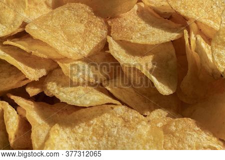 A Macro View Of The Yellow Potato Chips Background Pattern