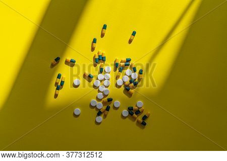 A Small Bunch Of Different Medicine Pills Flat Lay On The Colorful Background, Minimalism Helthcare