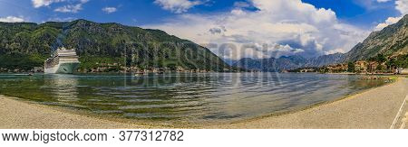 Panorama Of Kotor Bay With A Cruise Ship And Mountains Reflecting In The Water, Balkans On Adriatic
