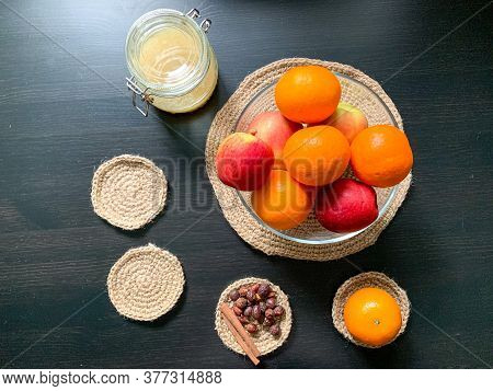 On A Black Wooden Table, Oranges, Apples, Honey, And Cinnamon Lie In Glass Dishes.ingredients For Mu