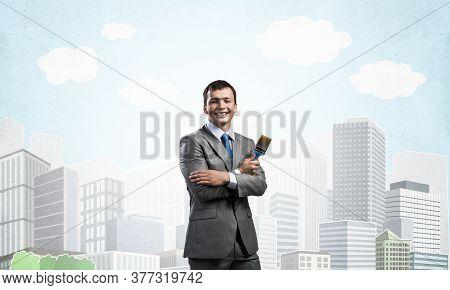 Confident And Creative Businessman Painter Standing With Arms Folded. Happy Handsome Man In Business