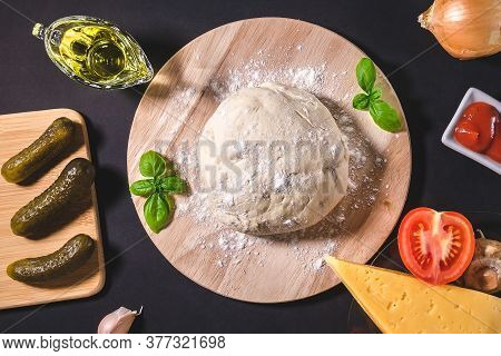 Making Of Pizza Concept With Yeast Dough Organic Pizza Ingredients. Top View Of Pizza Ingredients An