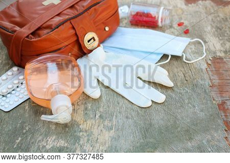 First Aid Kit On Wooden Background. Concept Of Protect Yourself From Covid-2019.