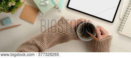 Female Student Hands Holding Coffee Cup While Sitting At Worktable With Mock Up Tablet And Stationer