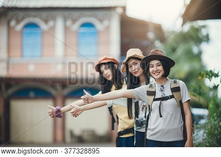 Asian Woman Group Backpacker Wearing Hat, Young Female Hitchhiking On Street, Friendship Traveller B