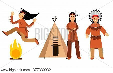 Red Indian Or American Indians Men And Woman In National Clothing Standing Near Teepee And Dancing A