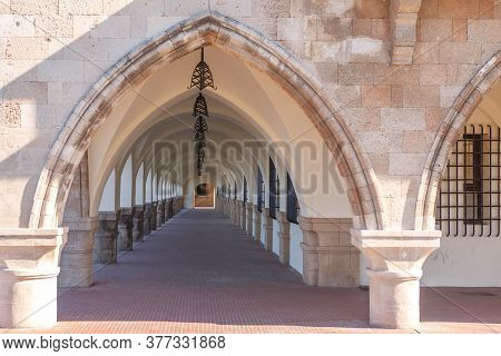Old Antique Curved Structure Forming Passage Building. The Building Of The Prefecture On The Island