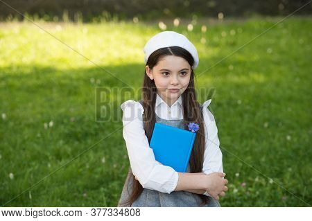 Back To School Look. Little Child Back To School. Little Girl Hold Book In Uniform. September 1. Bac