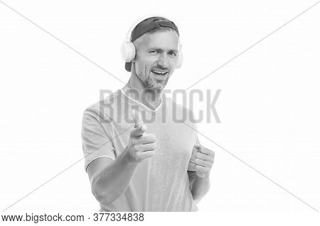 Electronics Shop. Guy In Cap Listen Music Stereo Headphones. Good Mood. Modern Wireless Headphones.