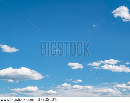 Blue Sky With White Clouds In Sunlight. Cloudy Landscape. Nature. Space. Background Image. Place For