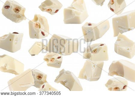 Delicious Chocolate Chunks Falling On White Background