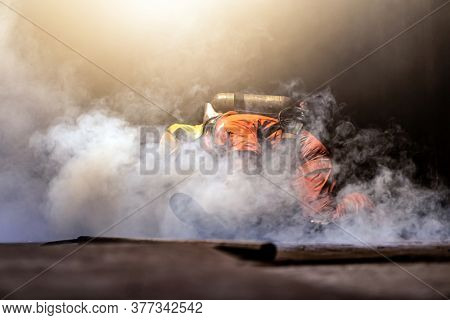 Firefighter check and rescue a man in building with smoke from fire inside. Firefighter safety rescue from accident and public service concept.