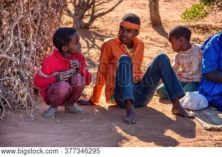 african village family sitting in the  yard of a village in Botswana