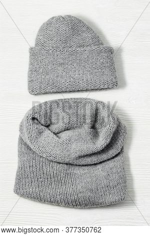 Handmade Knitted Clothing, Woolen Hat And Soft Snood. Warm Things For Winter Season. Top View. Copy