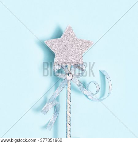 Glowing, Glittering Star On Blue Background. Minimal Greeting Card For New Year Or Christmas Holiday