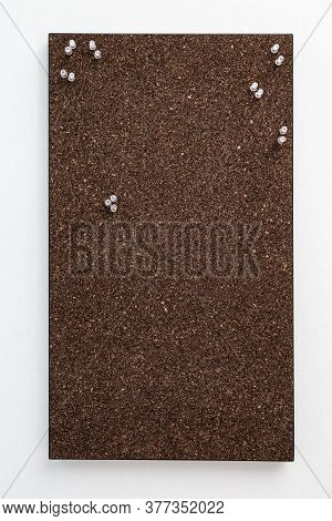 Bulletin Board From Dark Brown Cork Material With Transperent Pins For Stickers. Textured Wooden Cor
