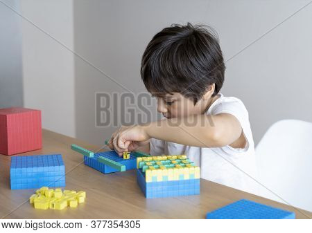 School Kid Using Plastic Block Counting Number, Child Boy Studying Math By Colour Stack Box, Dienes