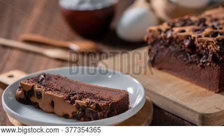 Chocolate Flavor Taiwanese Traditional Sponge Cake (taiwanese Castella Kasutera) On A Wooden Tray Ba