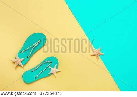 Flat Lay Of Composed Miniature Of Beach Lounge Area With Summer Shoes - Flip-flops And Small Sea Sta