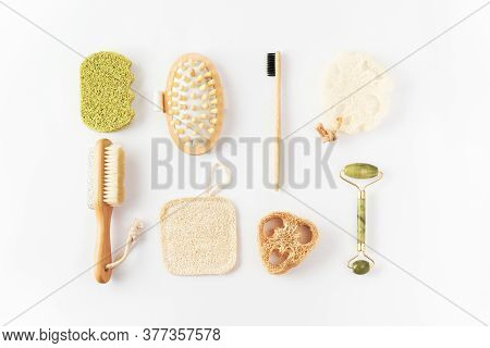 Eco Friendly Items On White Surface. Bamboo Toothbrush, Detangling Hair Brush, Exfoliating Loofah Sp