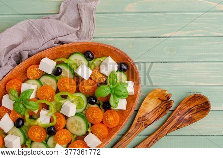 Salad Raw Vegetables And Cheese In A Dish On A Wooden Background. Selective Focus.
