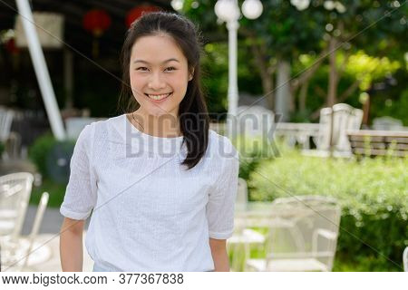 Happy Young Beautiful Asian Woman Smiling At The Coffee Shop Outdoors