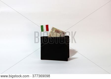 One Thousand Lire Of Italy Banknote And Mini Italia Nation Flag Stick On The Black Wallet With White