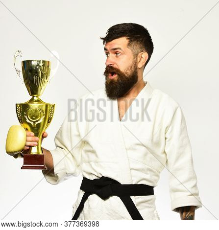 Combat Master Celebrates Victory In Competition. Man With Beard In Kimono On White Background