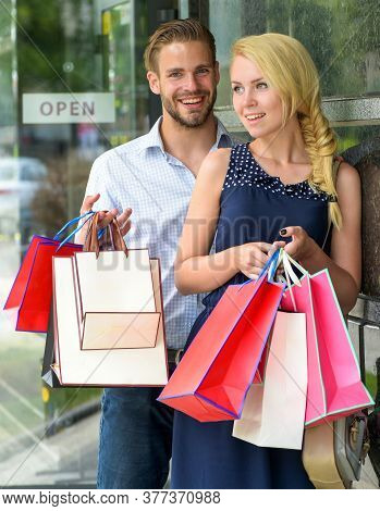 Smiling People With Shopping Bags. Man With Woman Or Wife