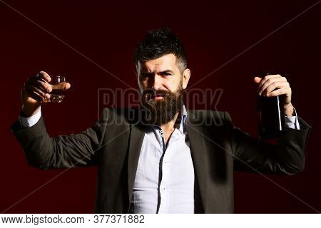 Partying And Drinking Concept. Sommelier With Beard Tasting Alcohol