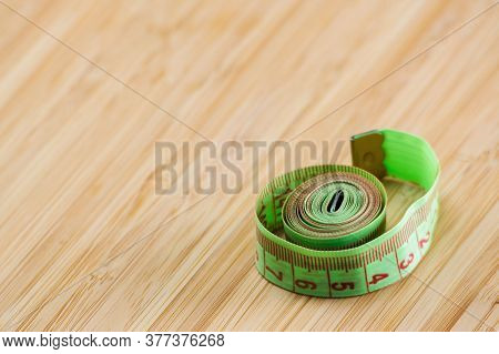 Diet. Restriction In Nutrition. Measuring Tape On The Table With Space For Text. Slimming. Weight Lo