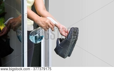 Woman Take Off Her Shoes And Clean With Alcohol Before Entering A House For Protect Infected From Co
