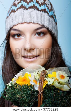 smiling woman in cap with basket of flowers