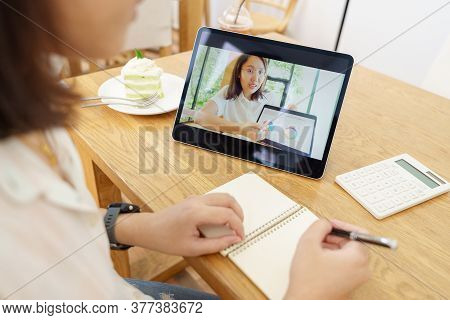 Asian Woman Aged 30-35 Years Using Tablet, Watching Lesson Online Course Communicate By Conference V
