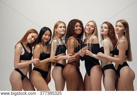 Group Of Women With Different Body And Ethnicity Posing Together To Show The Woman Power And Strengt