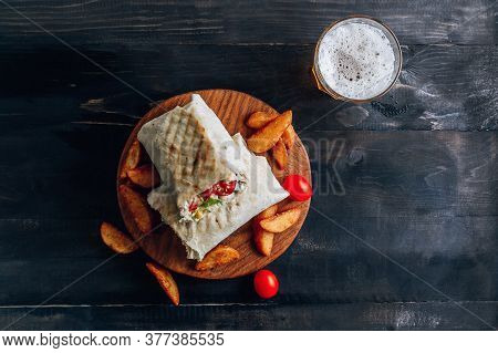Doner Kebab Or Shawarma. Grilled Chicken In Pita Bread With Tomatoes, Corn And Green Salad On Wooden