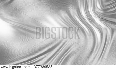 Silver Satin Or Silk Background With Little Waves. Silver Drapery Silk Fabric In The Wind. Abstract