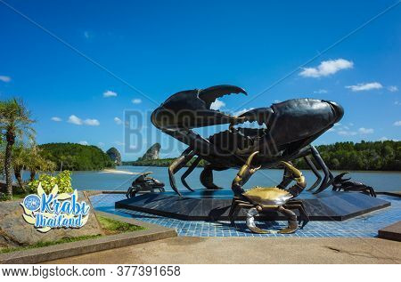 Krabi, Thailand - February 12, 2020: Statue of giant black crab - symbol of town. Near Pak Nam Krabi river