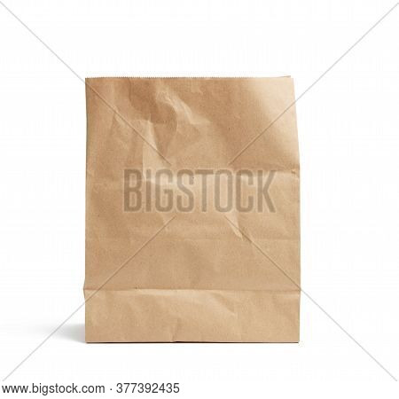 Disposable Bag Of Brown Kraft Paper Isolated On White Background, Concept Of Rejection Of Plastic Pa