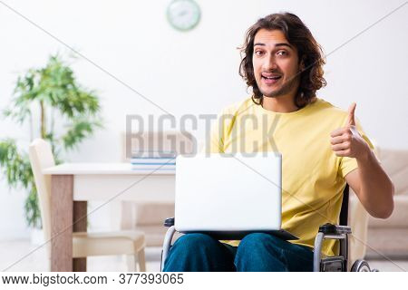 Male disabled student preparing for exams at home