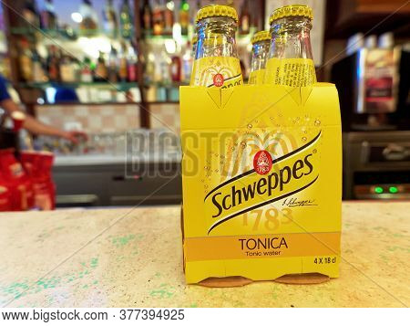 Rome, Italy - June 12, 2015. Schweppes Tonic Water, Pack Of Four, On A Bar Counter. Schweppes Tonic