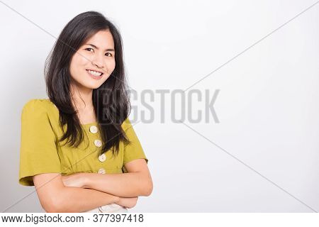 Portrait Asian Beautiful Young Woman Standing Smile Seeing White Teeth, She Crossed Her Arms And Loo